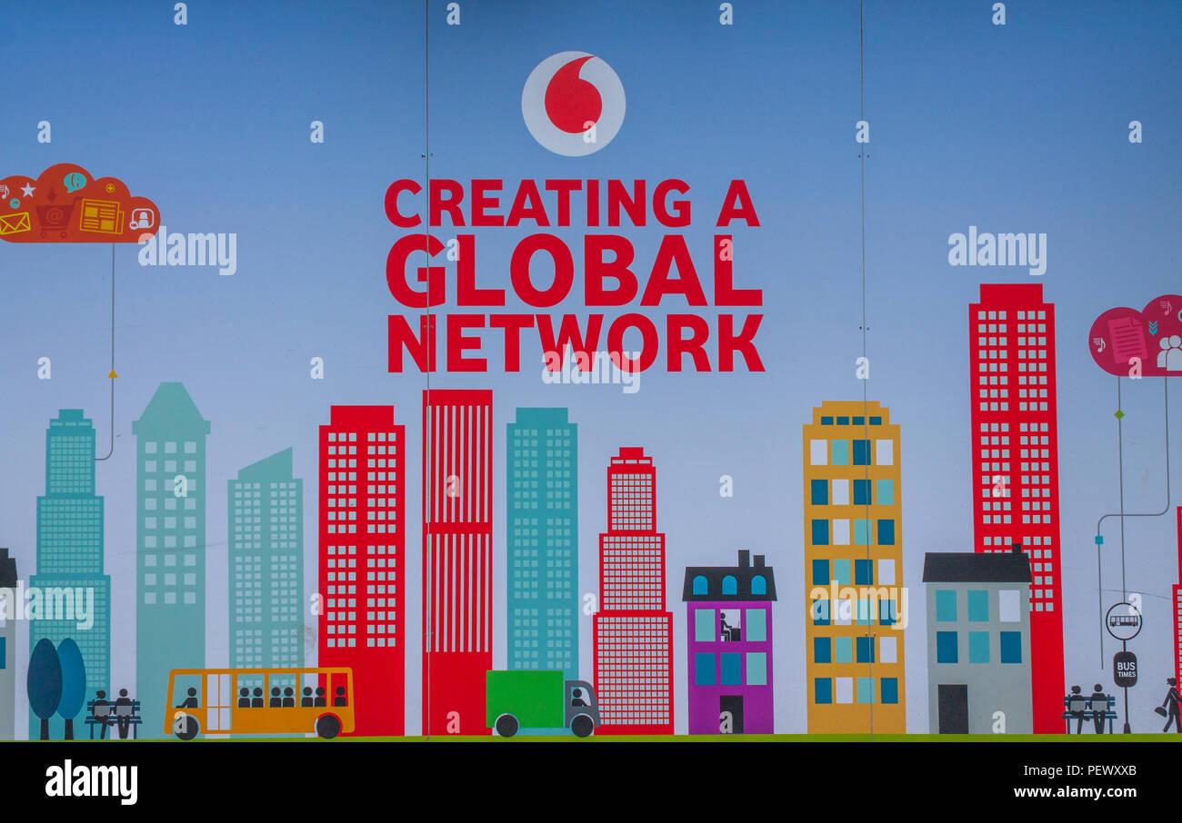 vodafone-logo-advertising-a-global-network-on-an-advertising-hoarding-or-advertising-board-PEWXXB.jpg