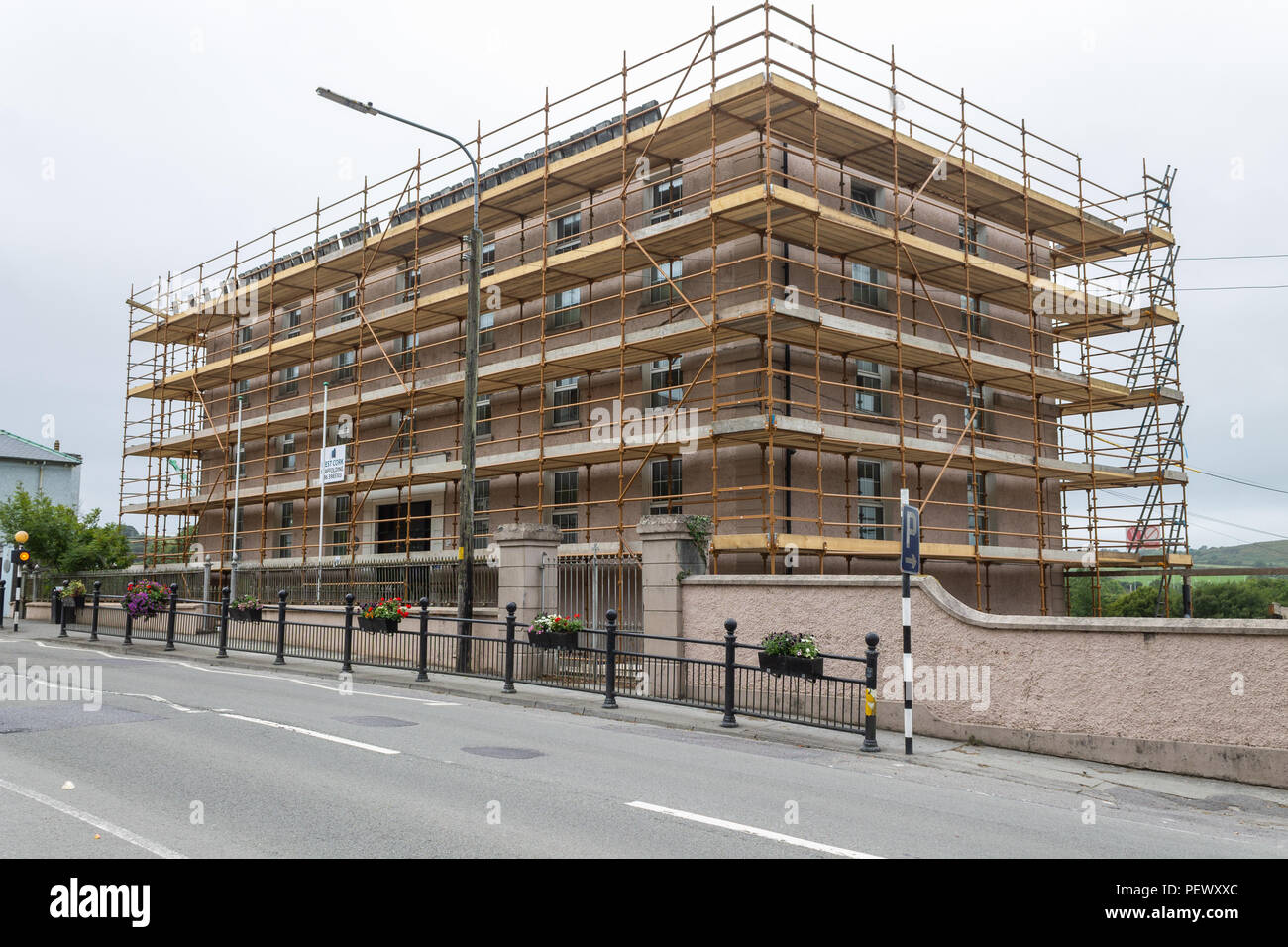 old-school-building-covered-in-scaffolding-ireland-PEWXXC.jpg