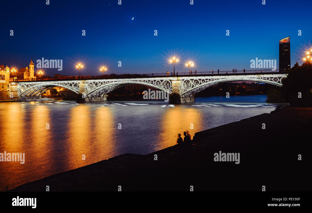 long-exposure-blue-hour-view-of-puente-de-triana-or-triana-bridge-in-seville-andalusia-spain-PEY30F.jpg