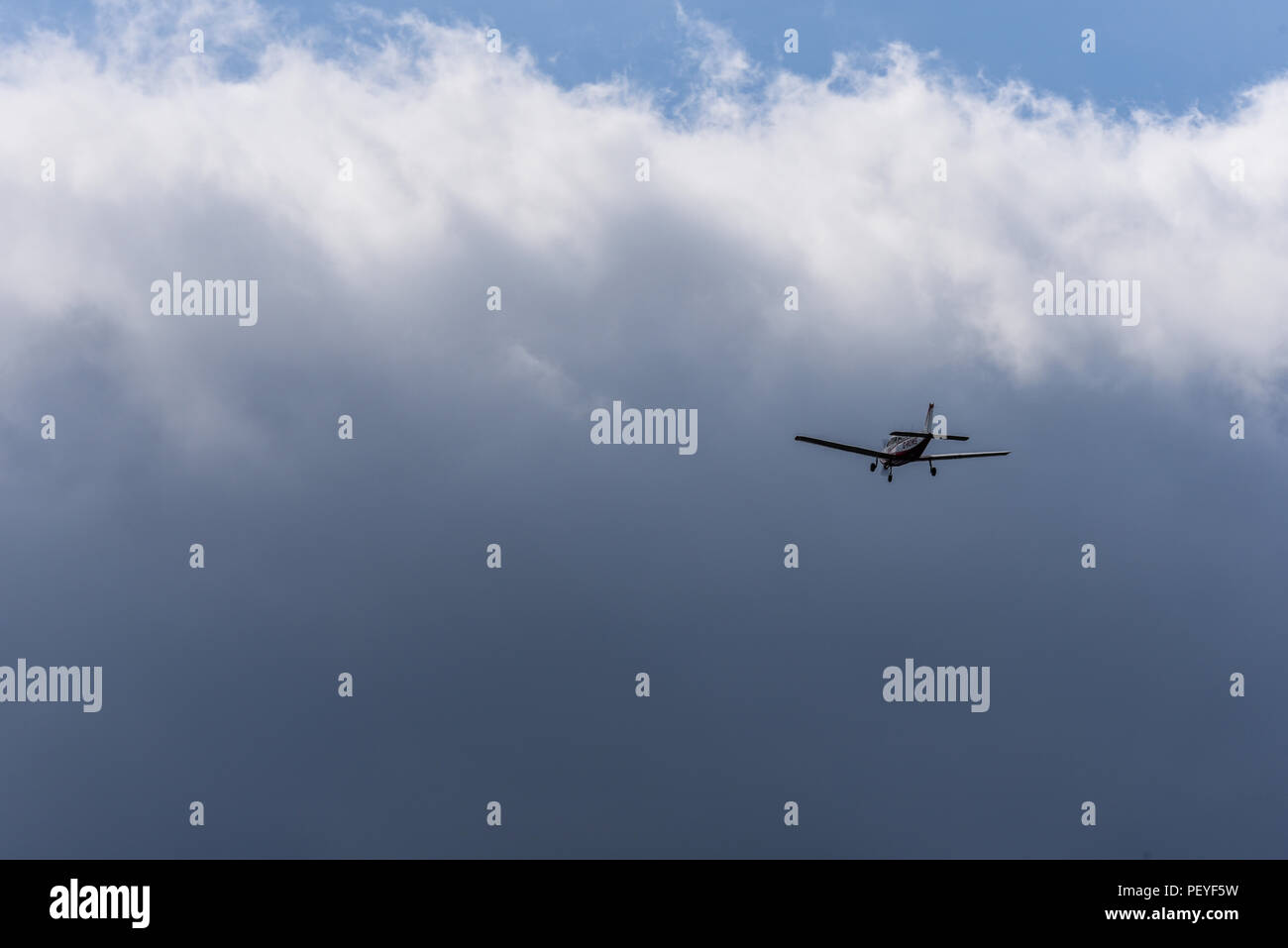 flying-into-weather-in-single-light-aircraft-small-ga-general-aviation-plane-flying-towards-clouds-visual-meteorological-conditions-private-flying-PEYF5W.jpg