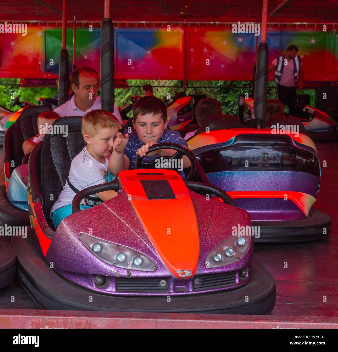 children-riding-the-dodgems-or-bumper-cars-on-a-fairground-ride-PEYGB1.jpg