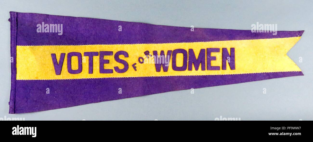 Purple and yellow pennant or banner, with the words 'Votes for Women, ' likely produced by Alice Paul's National Woman's Party, for the American market, 1900. Photography by Emilia van Beugen. () Stock Photo