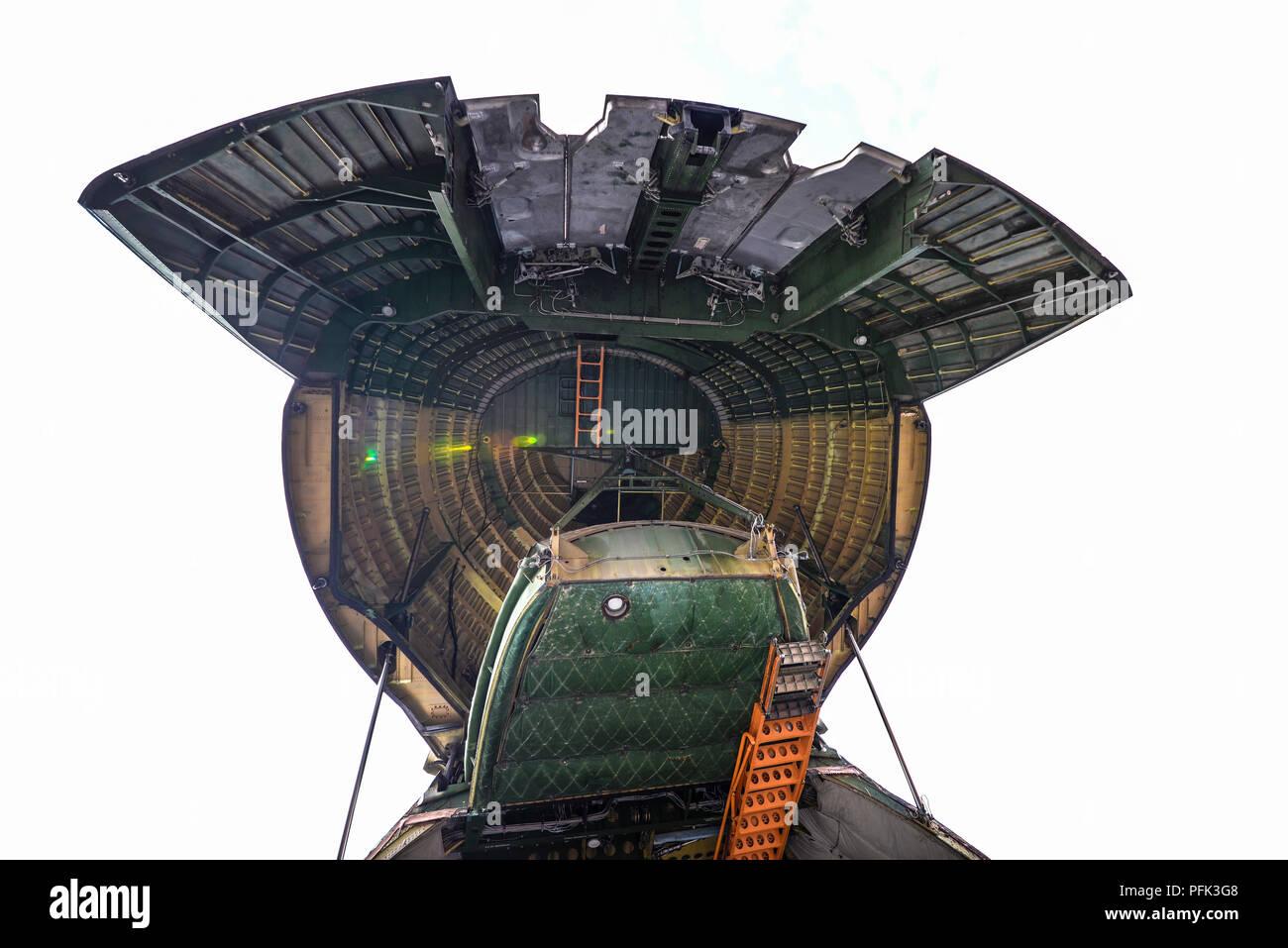 inside-the-huge-raised-nose-door-of-a-antonov-an-124-plane-at-farnborough-international-airshow-aerospace-aviation-trade-show-cavernous-cargo-door-PFK3G8.jpg