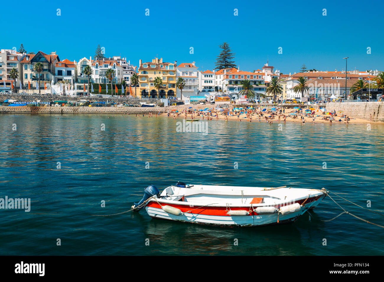 cascais-portugal-august-21-2018-fishing-boat-on-foreground-with-crowded-sandy-beach-in-cascais-near-lisbon-portugal-during-the-summer-PFN134.jpg