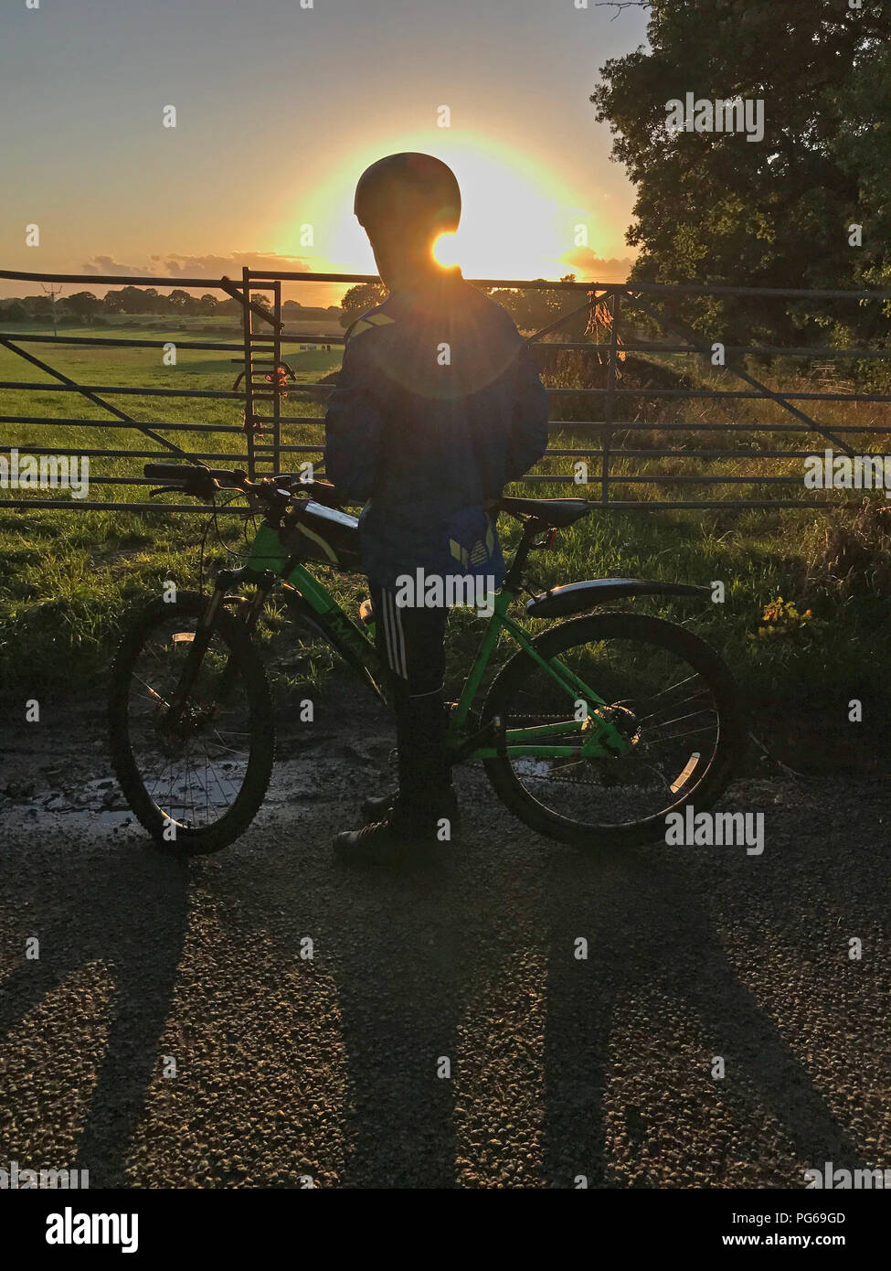 @Hotpixuk,sunset behind,Youth,boy,girl,cycle,bicycle,countryside,dusk,dawn,at dusk,MT,cycling,sun,sunshine,cyclist,sunset cyclist,sunrise cyclist,Cheshire,UK,England,North West England,summer,shadow,shadows,rider,riding,transport,commuting,gate,gates,country lane,rural,rural lane,getting out by bike,getting out by cycle,GoTonySmith