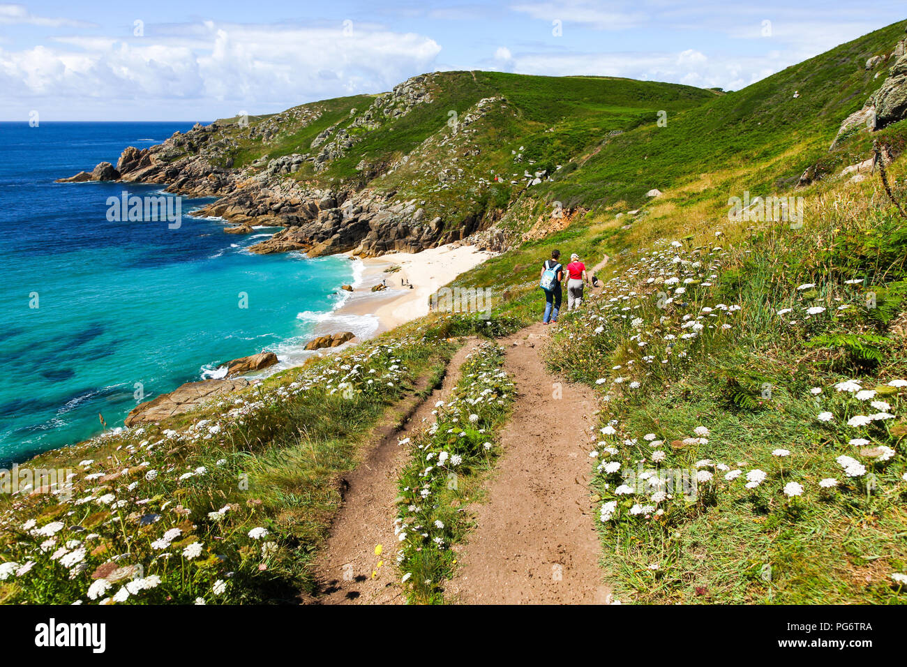 people-walking-on-the-footpath-above-porthchapel-or-porth-chapel-beach-cornwall-south-west-england-uk-PG6TRA.jpg