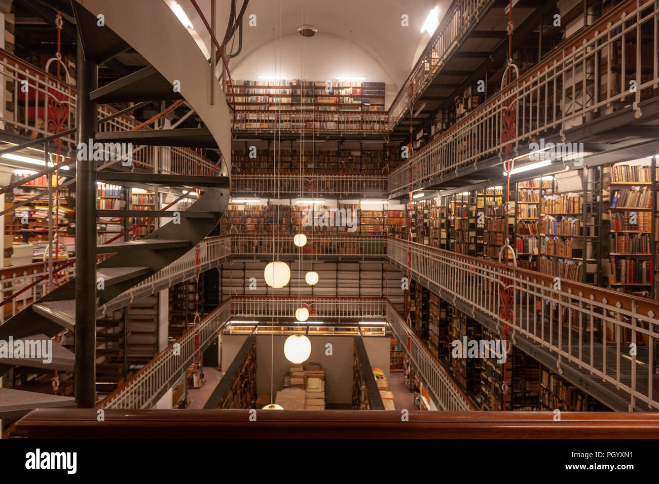 Spiral Staircase and books shelf in the in the Royal Danish Library The old building, The Black Diamond library, Copenhagen, Denmark. Stock Photo