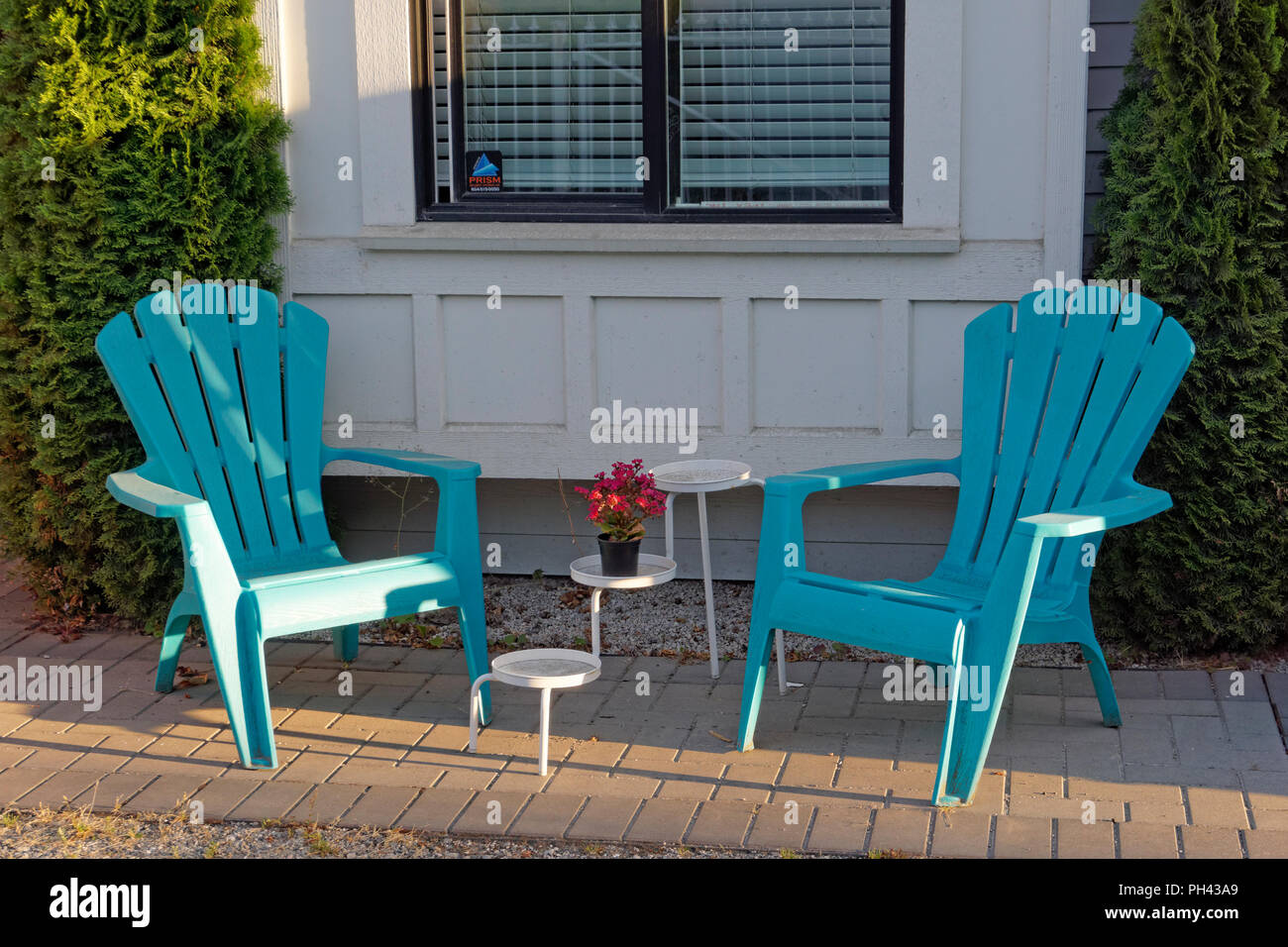 two-plastic-adirondack-chairs-on-a-summe