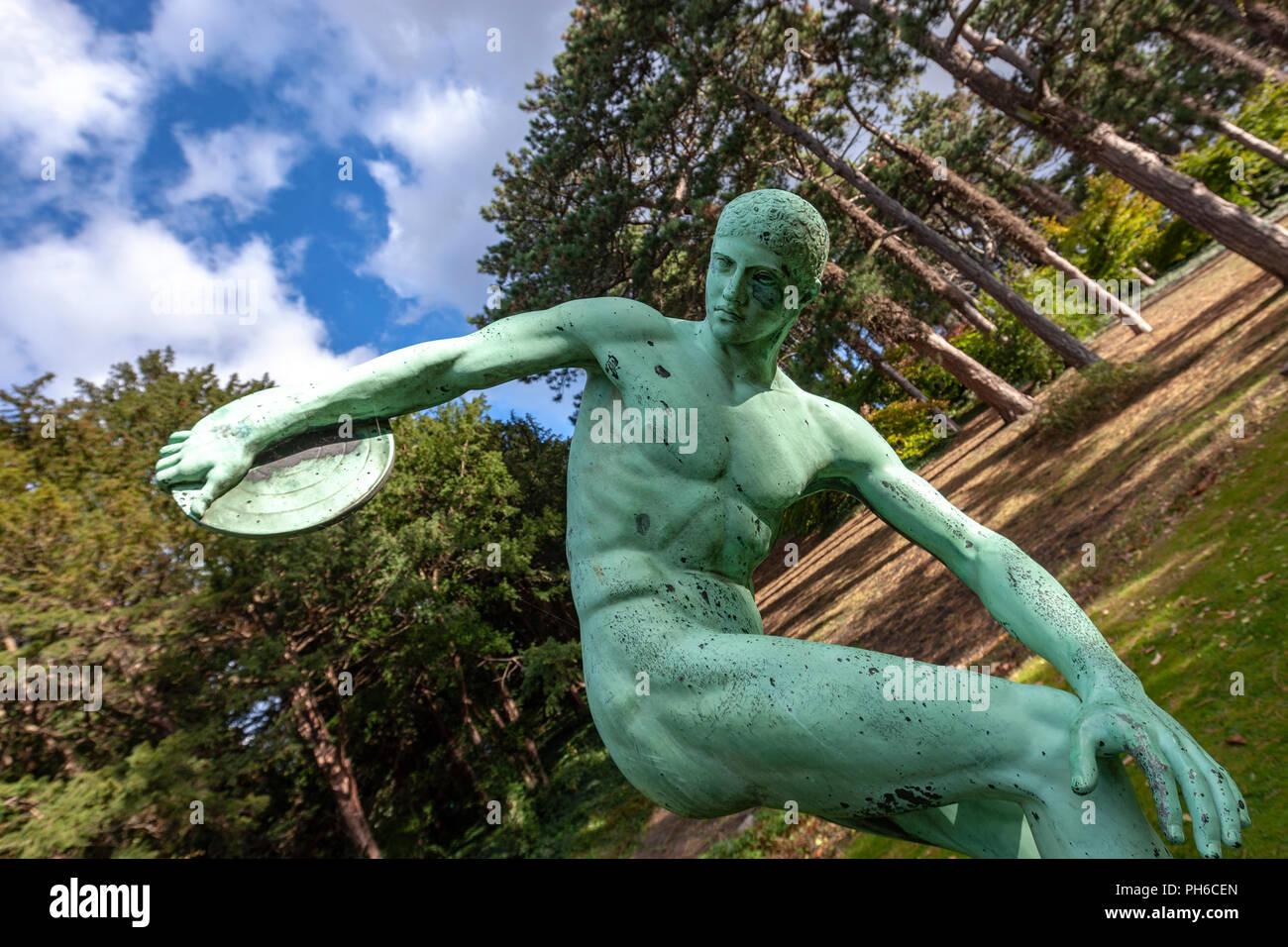 "Bronze copy of Myron of Eleutherae's ""Discobolus"" (discus thrower) in University of Copenhagen Botanical Garden, Copenhagen, Denmark. Stock Photo"