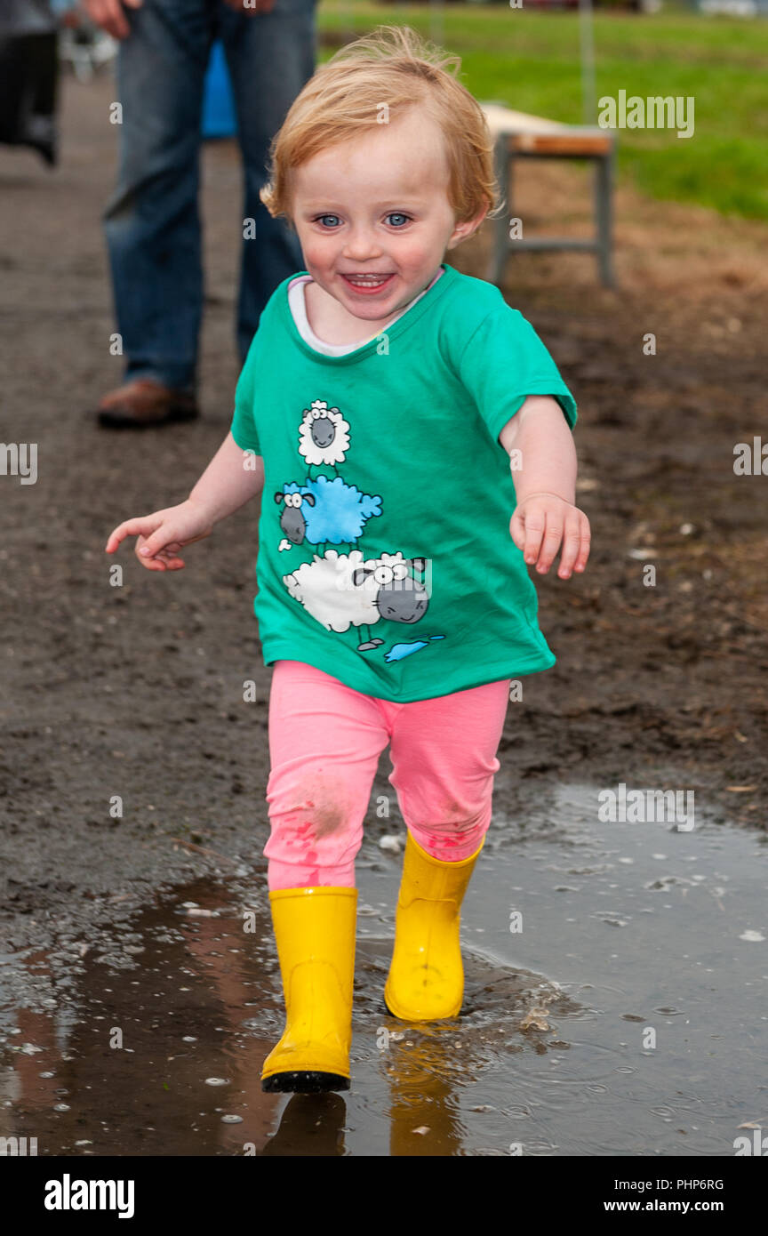 bantry-west-cork-ireland-2nd-sept-2018-bantry-agricultural-show-is-taking-place-at-the-bantry-airstrip-today-in-appalling-weather-having-fun-in-the-puddles-was-1-12-year-old-laura-omahony-from-baltimore-credit-andy-gibsonalamy-live-news-PHP6RG.jpg