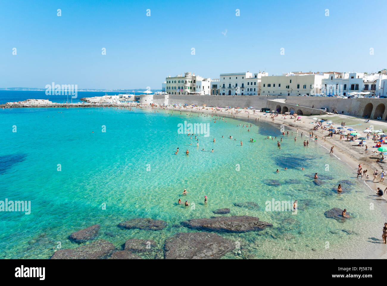 Panoramic view of public beach with italian people, Gallipoli, Lecce, Italy Stock Photo