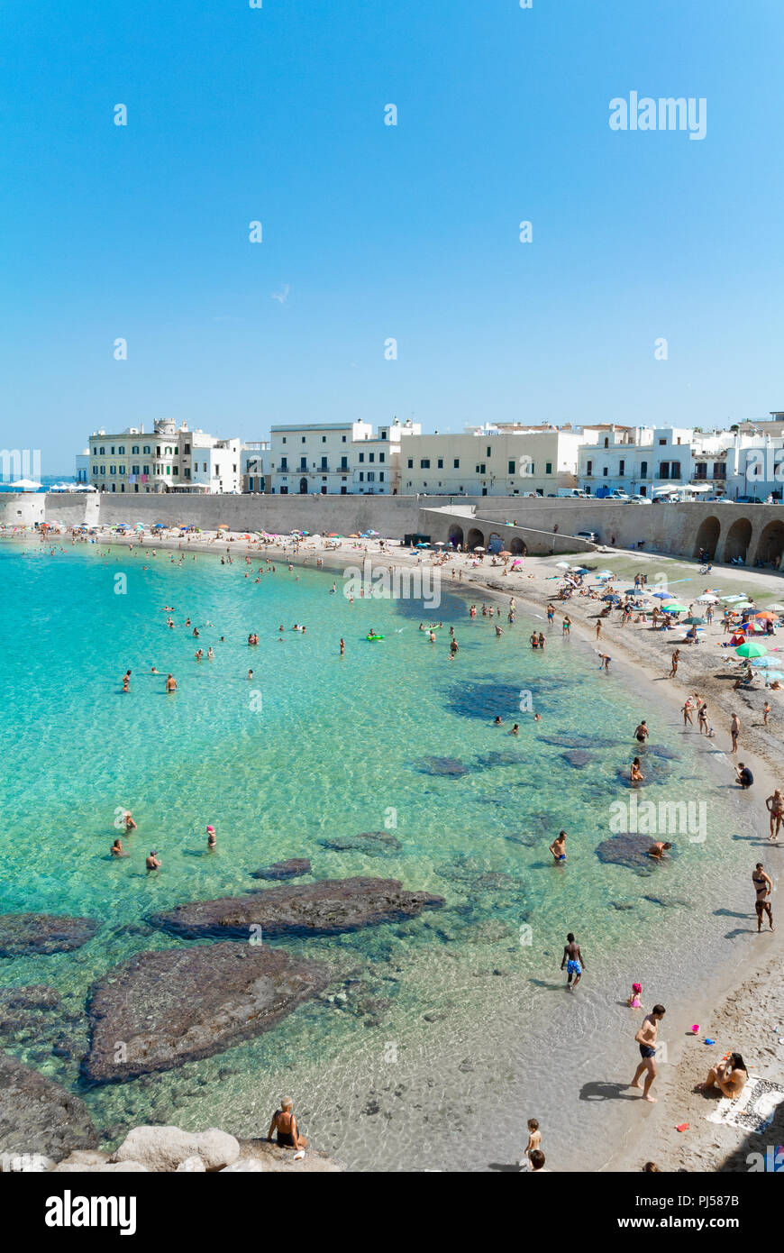 Public beach with italian people, Gallipoli, Lecce, Italy Stock Photo