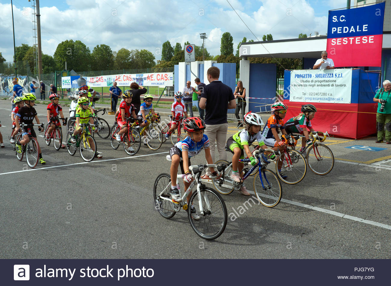 Children's bicycle race - moments before the start the riders take position before the off . Sesto San Giovanni, Milan, Italy. Stock Photo