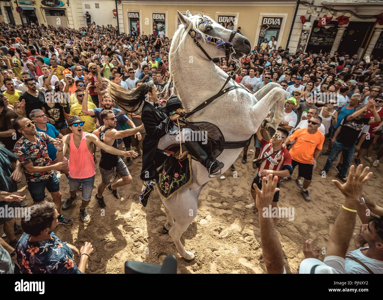 Mahon, Spain. 8 September, 2018:  A 'caixer' (horse rider) rears up on his horse after the 'Jaleo' of the traditional Gracia Festival in Mahon, celebrating its patron, Our Lady of Grace. Credit: Matthias Oesterle/Alamy Live News Stock Photo