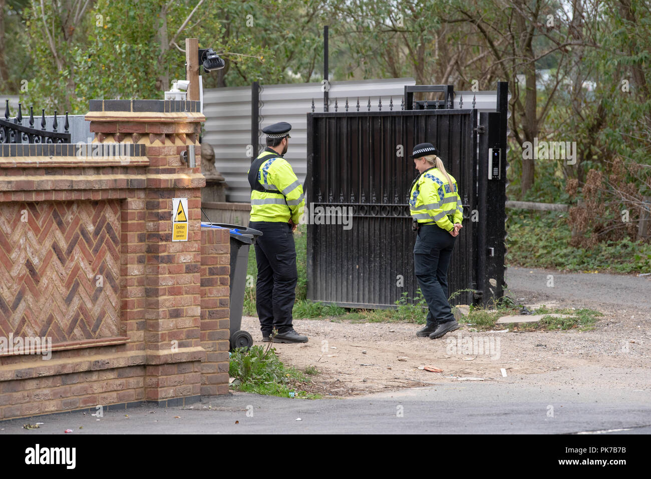 Iver, United Kingdom. 11 September 2018. Thames Valley Police has made three arrests following modern slavery warrants carried out in South Buckinghamshire. The arrests were made in connection with warrants carried out at a residential property in Love Lane, lver, South Buckinghamshire. Eight people, believed to be victims of modern slavery, were also safeguarded by the force. Approximately 100 officers were involved in the operation which took place following allegations made about forced labour being carried out at building sites. Credit: Peter Manning / Alamy Live News Stock Photo