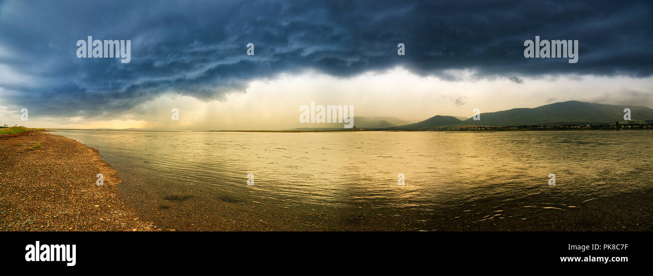 a-panorama-og-golden-evening-light-and-a-dramatic-summer-storm-reflected-in-the-lagoon-at-carleton-in-gaspesie-quebec-canada-PK8C7F.jpg