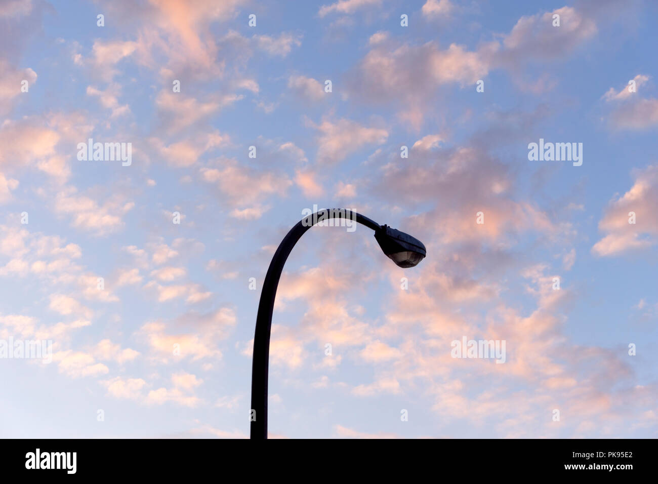 curved-streetlight-silhouetted-against-t