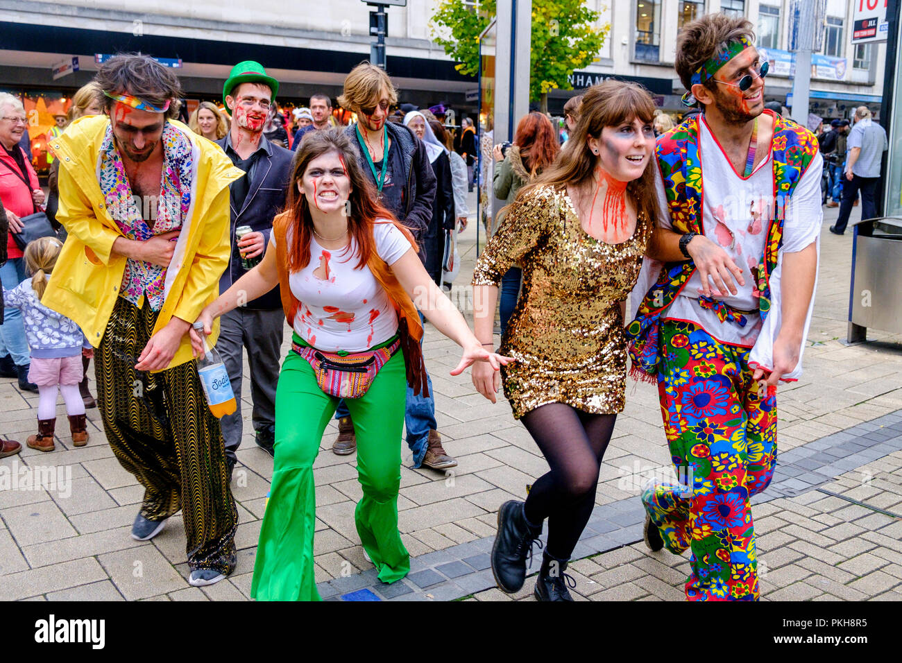 Bristol, UK. 28th Oct, 2017. People dressed as zombies are pictured as they take part in a zombie walk through the city centre. Stock Photo