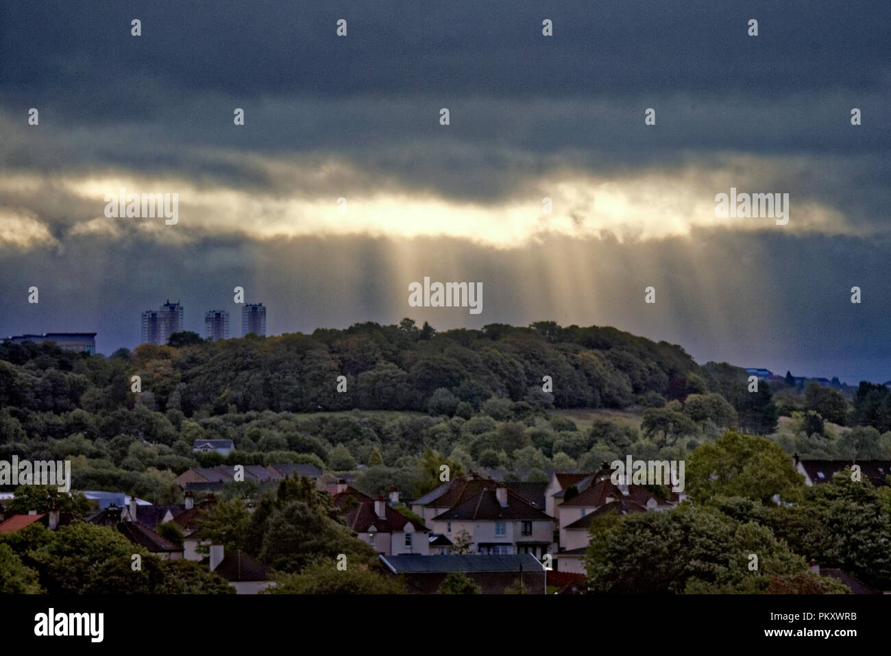 Glasgow, Scotland, UK, 16th September, 2018. UK Weather: God rays or Crepuscular rays over Dawsholm park and the towers of Maryhill and the east of the city as morning sun works its way through the dark storm clouds ahead of the really stormy weather forecast for tomorrow. Gerard Ferry/Alamy news Credit: gerard ferry/Alamy Live News Stock Photo