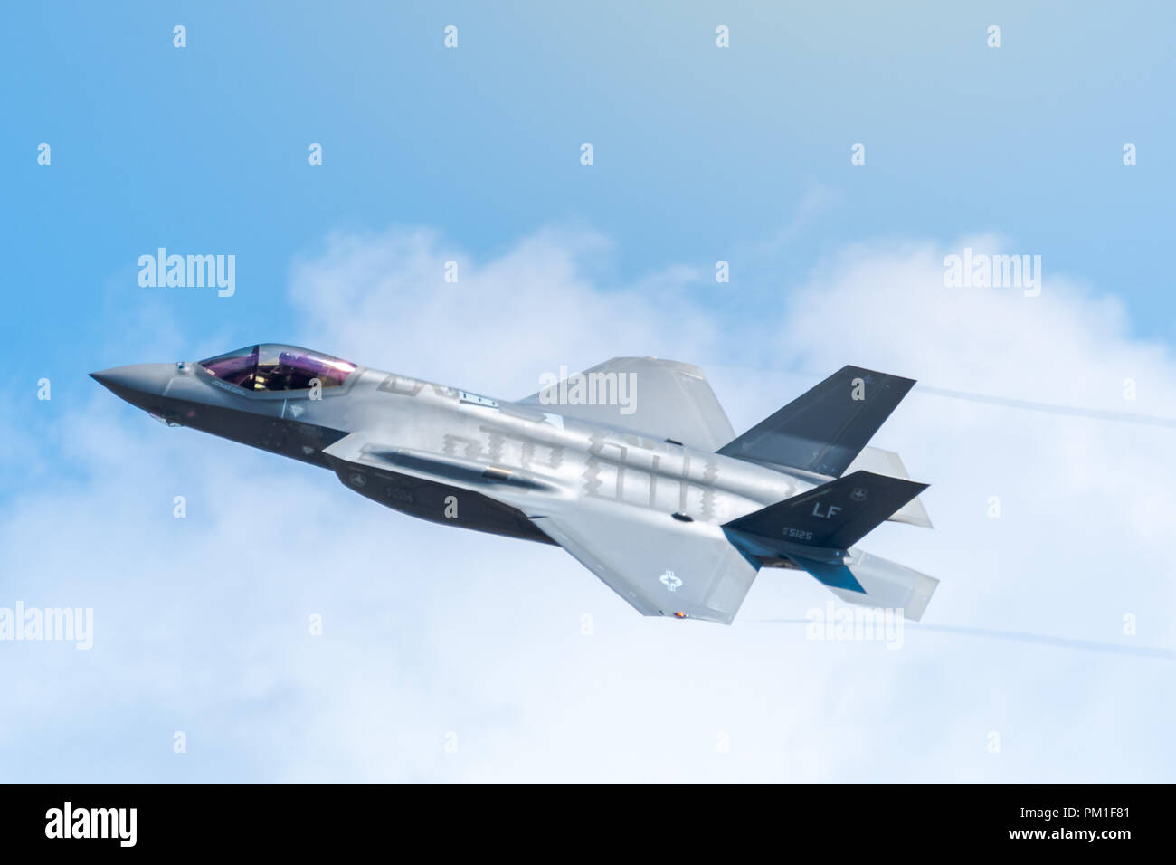 FAIRFORD, UK, JULY 13 2018: A photograph documenting a Lockheed Martin F-35 Lightning II stealth multirole fighter aircraft from the USAF displaying a Stock Photo