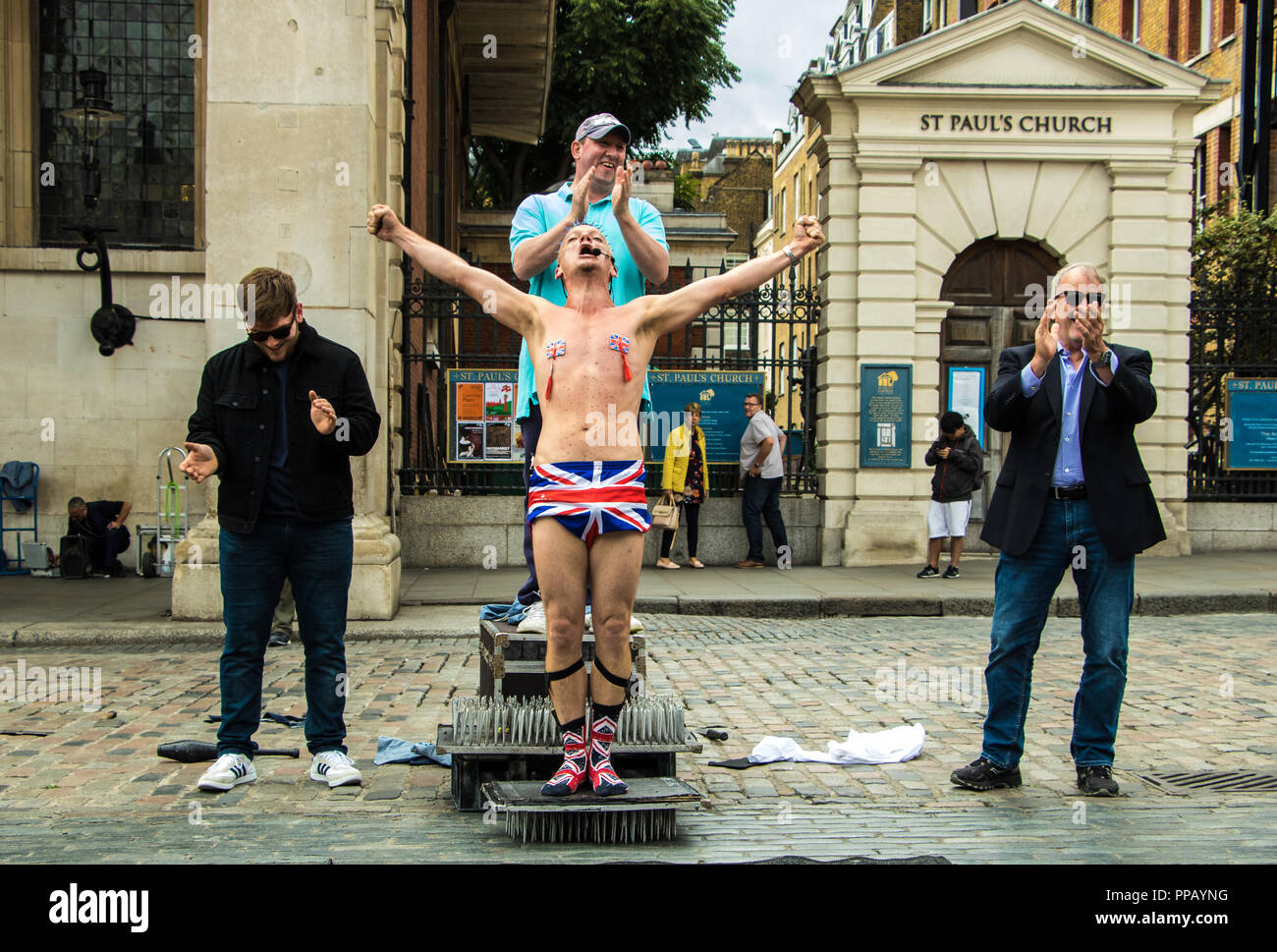 london-uk-sept-22-2018-shirtless-daredevil-performer-with-union-jack-underwear-performing-a-dangerous-stunt-for-a-crowd-in-covent-garden-PPAYNG.jpg