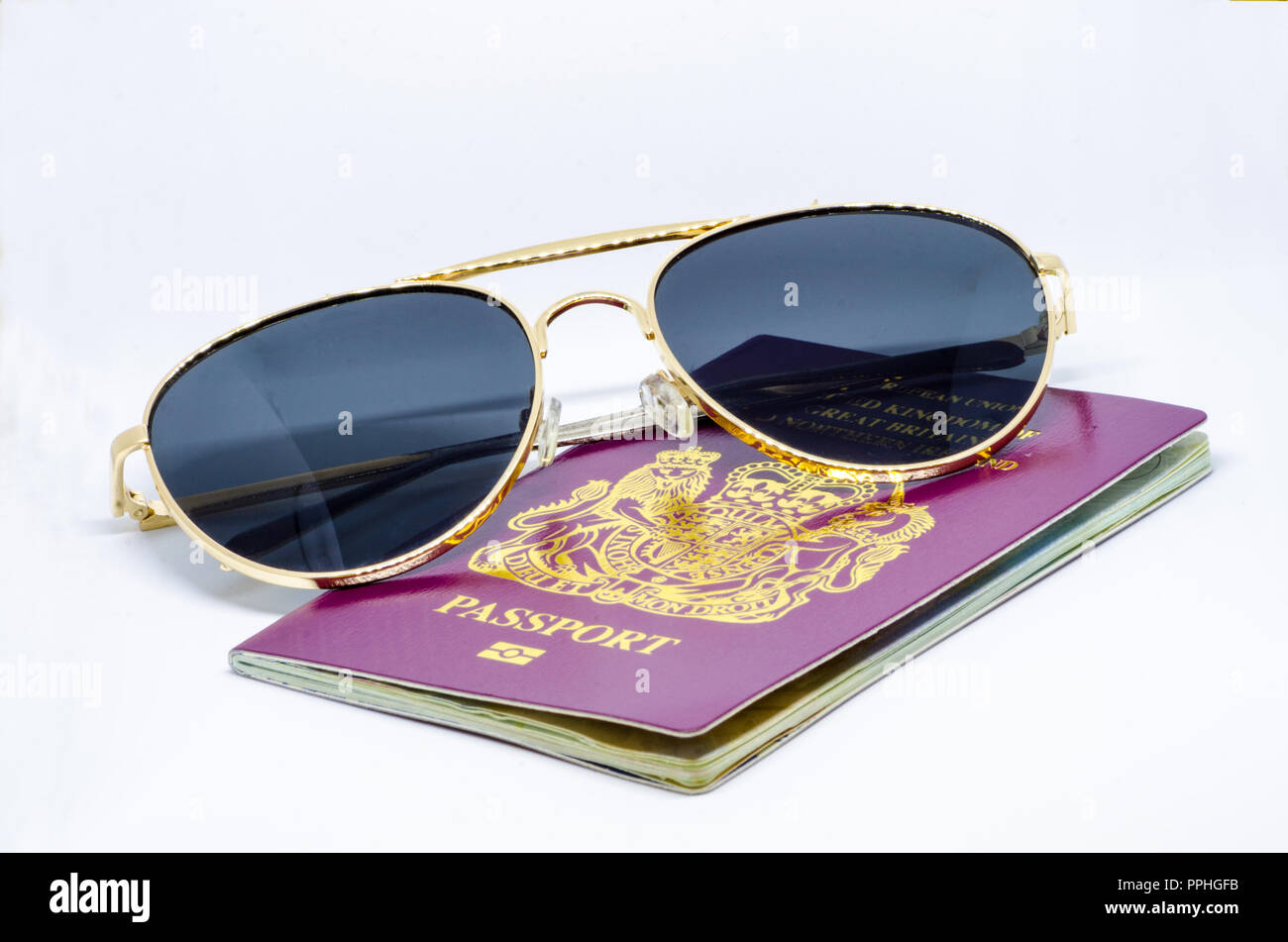 holiday-and-travel-concept-a-red-burgundy-british-european-passport-and-a-pair-of-sunglasses-on-a-white-background-PPHGFB.jpg