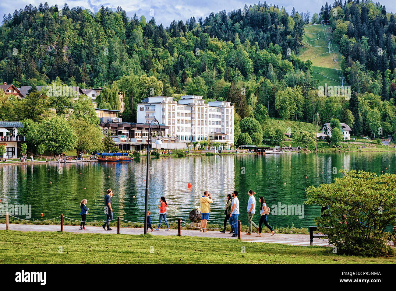 Bled, Slovenia - April 28, 2018: People passing by at Bled Lake, Slovenia Stock Photo