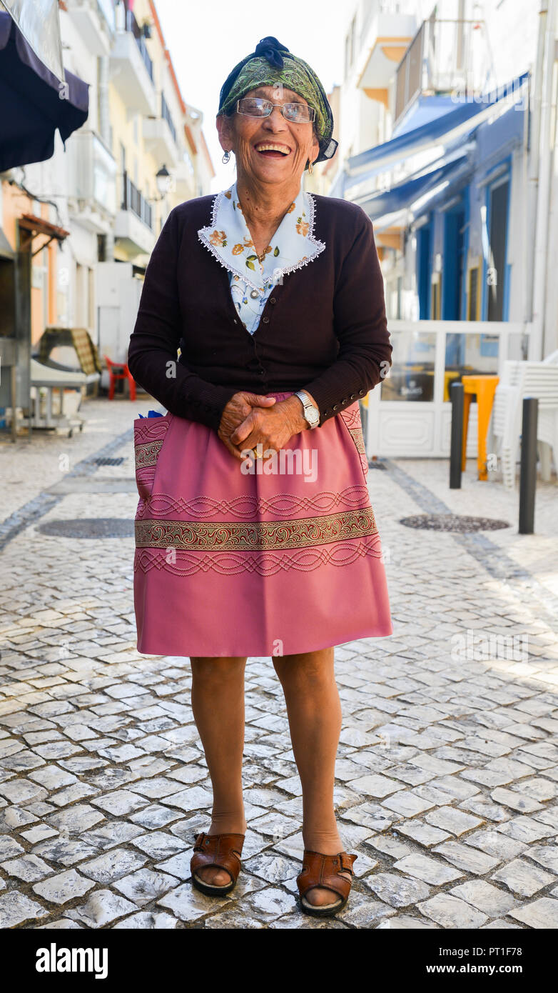 nazare-portugal-sept-25-2018-traditionally-dressed-elderly-portuguese-woman-on-a-cobblestone-street-of-nazare-portugal-PT1F78.jpg