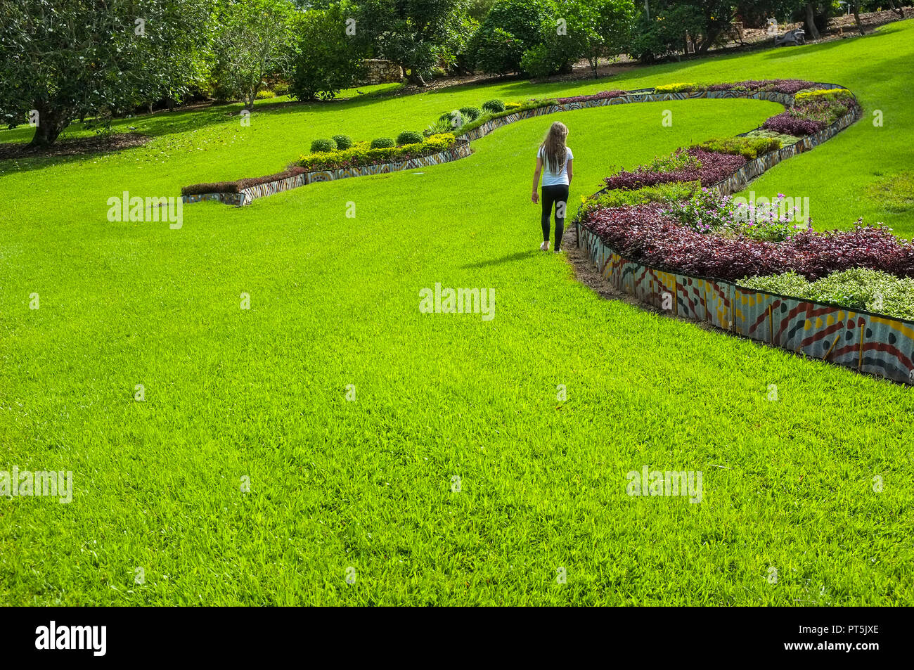 girl-walking-in-the-george-brown-darwin-botanic-gardens-the-gardens-nt-australia-PT5JXE.jpg