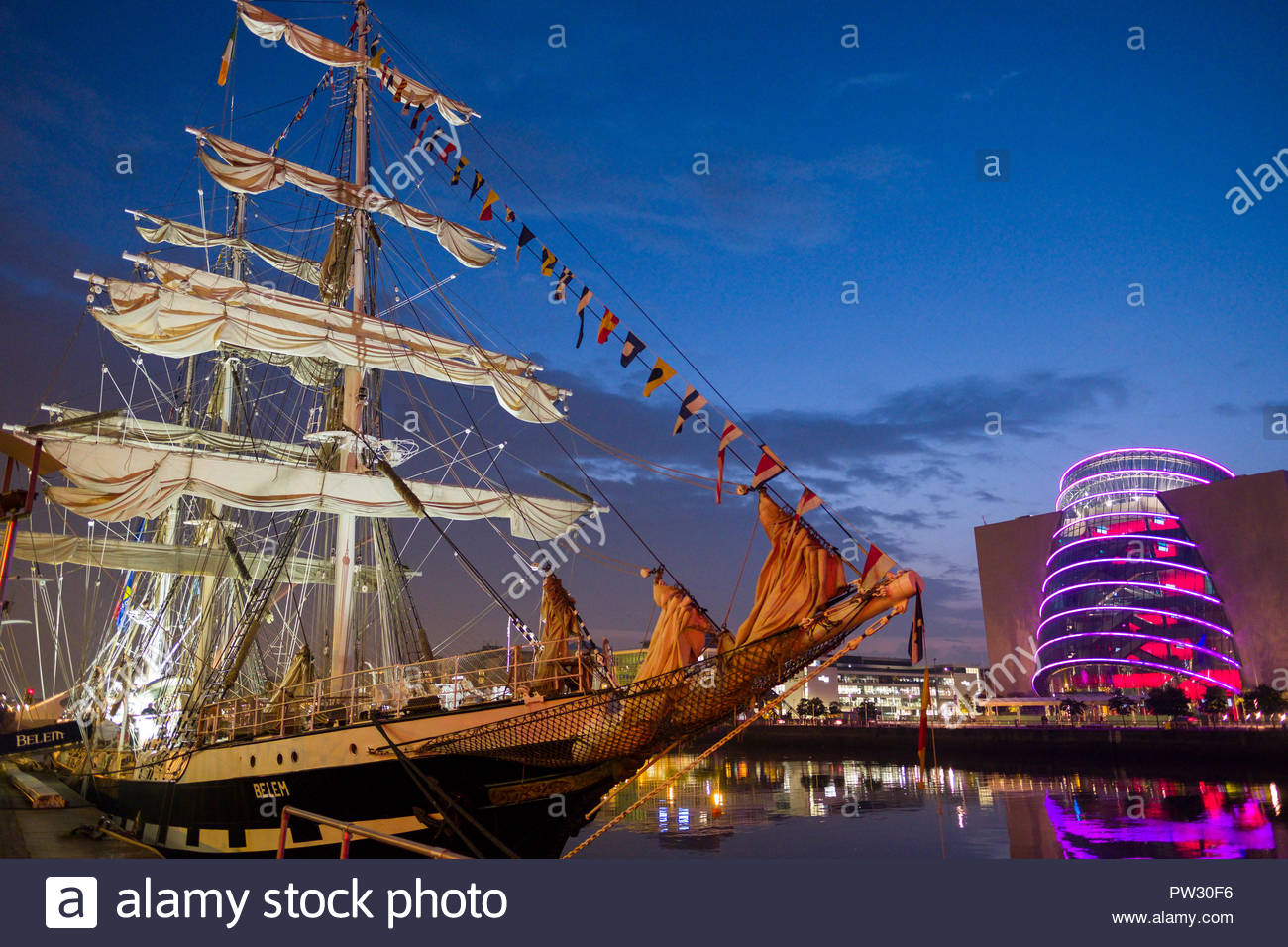 The tall ship Belem docked along the River Liffey at night during the 2018 Tall Ships Regatta, Docklands, Dublin, Leinster, Ireland Stock Photo