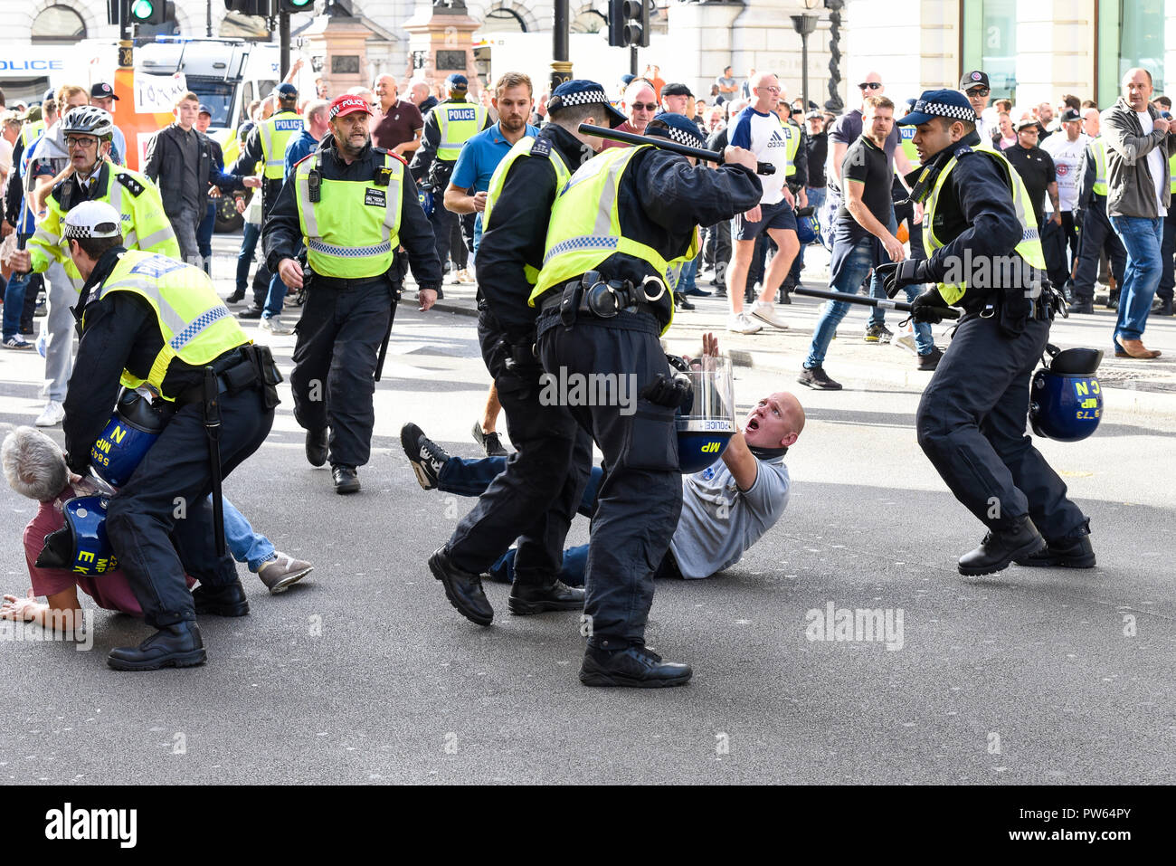 westminster-london-uk-13th-october-2018-the-right-wing-dfla-are-marching-towards-parliament-in-protest-against-returning-jihadists-treatment-of-veterans-migrants-rape-gangs-and-groomers-weak-sentencing-knife-crime-police-cuts-political-cover-ups-and-terrorism-regarded-as-racist-by-other-groups-such-as-stand-up-to-racism-an-opposition-march-has-been-organised-beginning-in-portland-place-to-also-head-towards-parliament-scuffles-with-police-took-place-credit-avpics-alamy-live-news-PW64PY.jpg