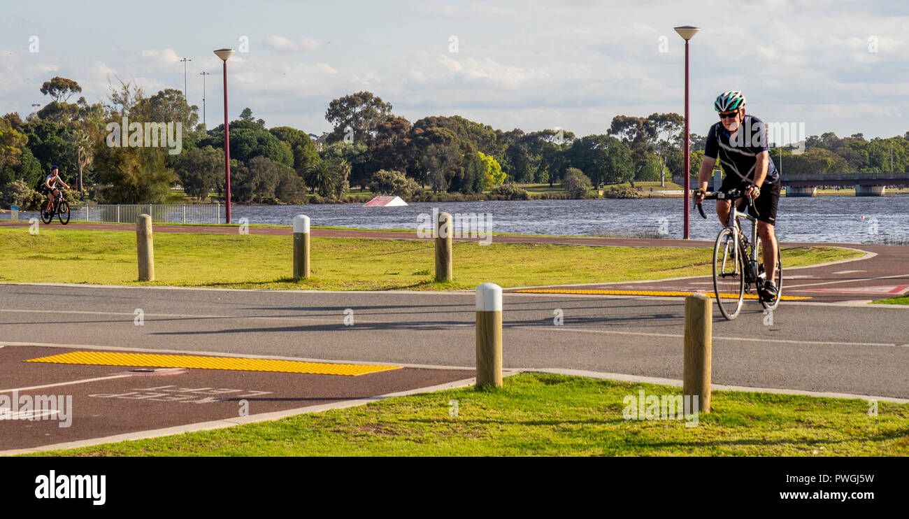 caucasian-male-riding-bicycle-cycling-along-swan-river-perth-western-australia-PWGJ5W.jpg
