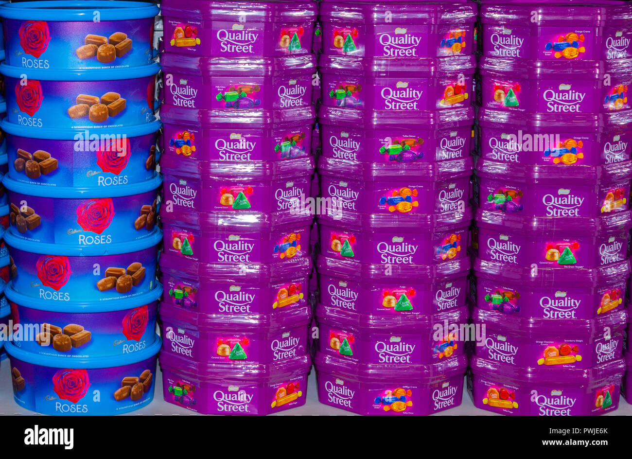 christmas-boxes-of-candy-or-chocolates-or-sweets-stacked-on-a-shop-shelf-PWJE6K.jpg