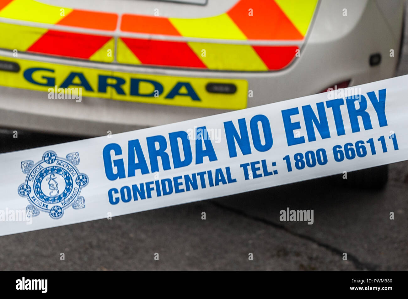 garda-irish-police-no-entry-tape-in-front-of-a-garda-patrol-car-at-an-incident-in-ireland-PWM380.jpg