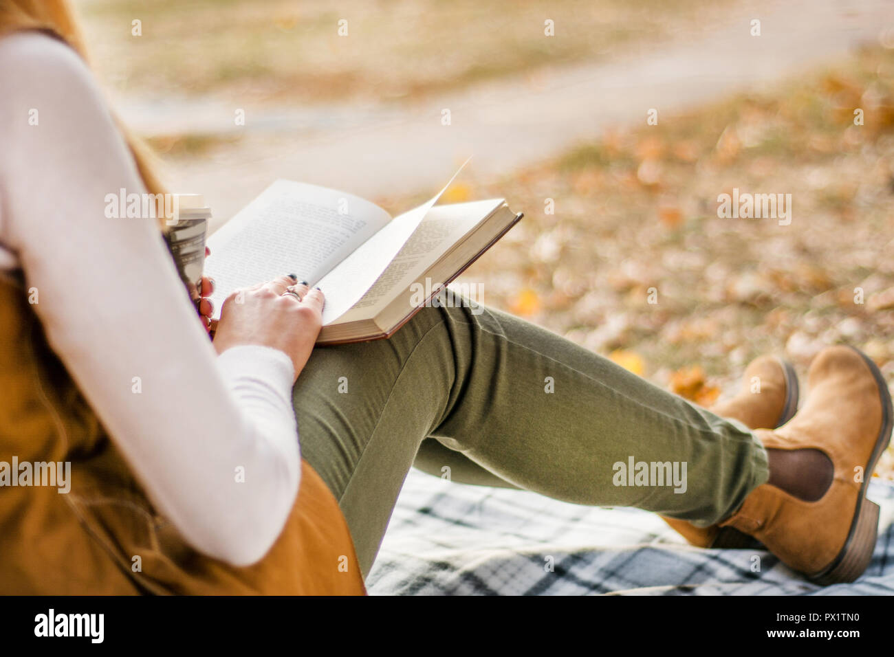 young-girl-reading-book-in-park-at-retro
