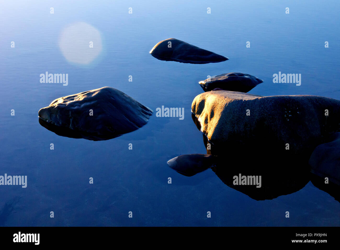 rocks-sitting-in-a-calm-rockpool-on-the-