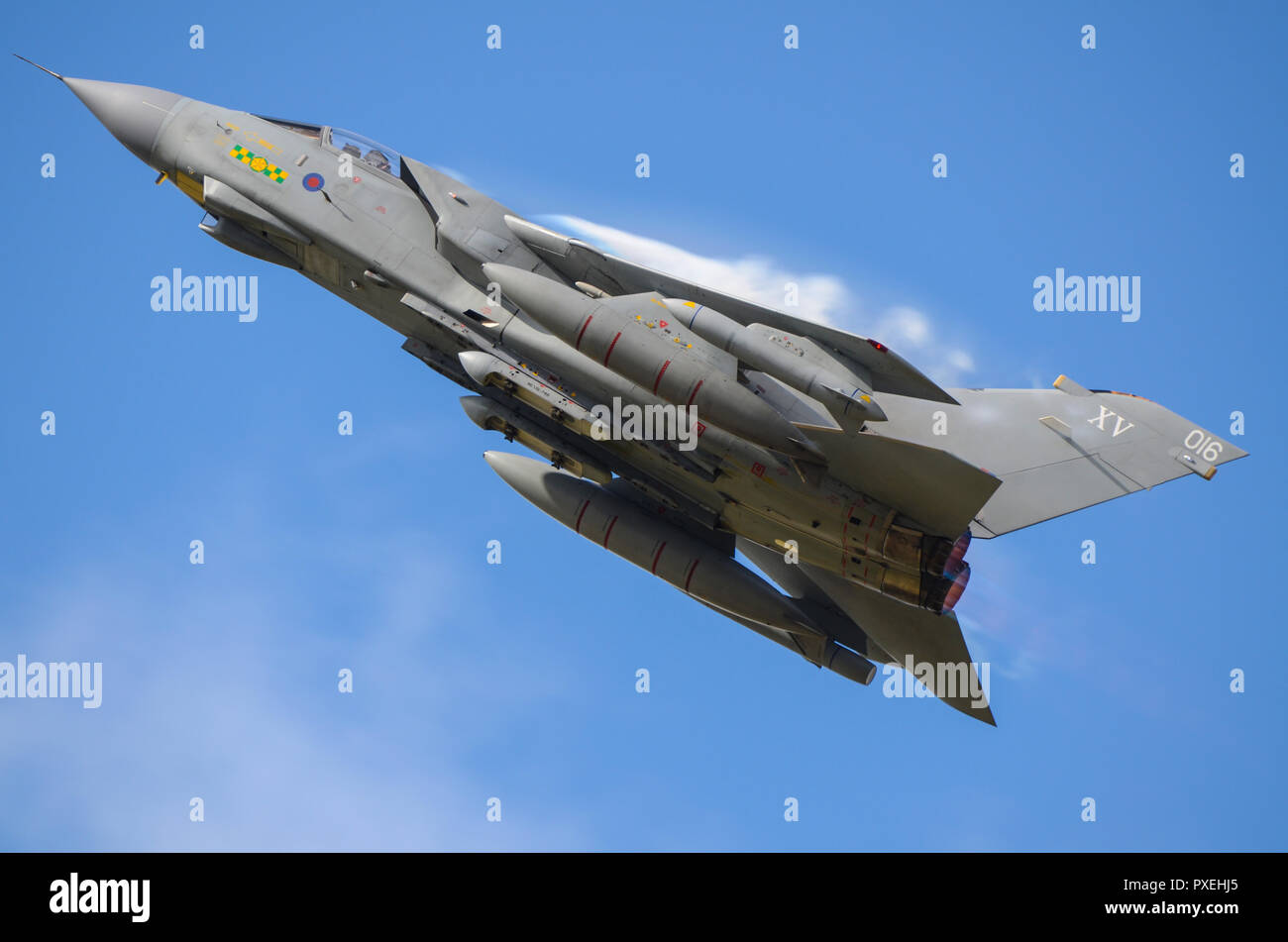 raf-royal-air-force-panavia-tornado-gr4-jet-fighter-bomber-plane-climbing-at-speed-with-vapour-condensation-forming-above-the-wing-blue-sky-PXEHJ5.jpg
