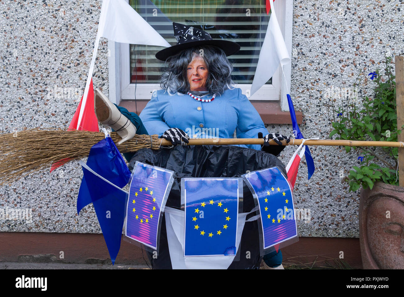 theresa-may-scarecrow-surrounded-by-european-union-flags-depicted-as-the-wicked-witch-of-brexit-in-a-front-garden-as-part-of-a-scarecrow-competition-for-halloween-PXJWYD.jpg