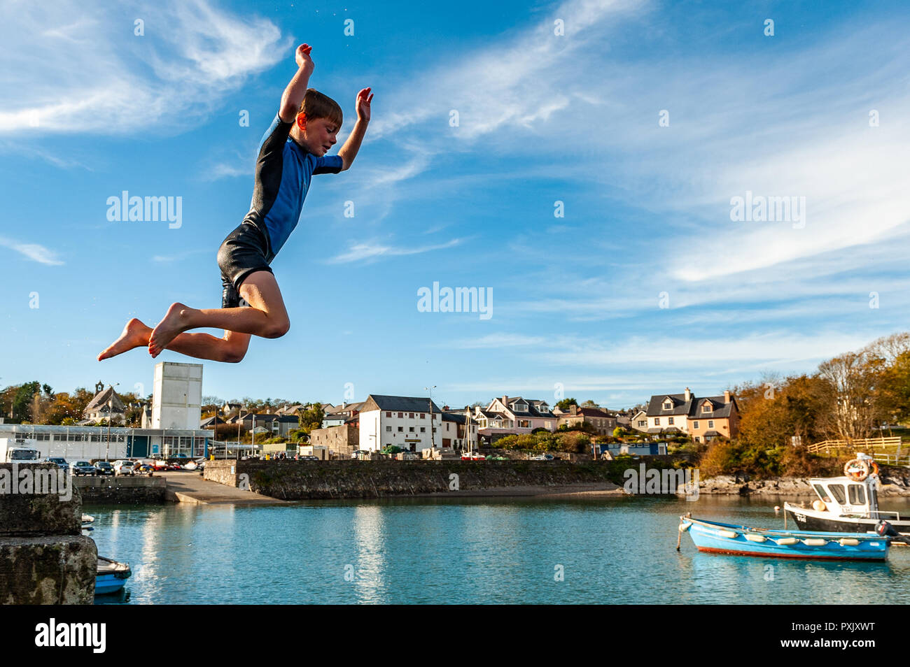 schull-west-cork-ireland-23rd-oct-2018-daniel-copithorne-from-ballydehob-makes-the-most-of-the-unseasonably-warm-weather-by-jumping-into-the-sea-off-schull-pier-sunshine-has-been-the-order-of-the-day-today-with-highs-of-13-15-celsius-in-west-cork-credit-andy-gibsonalamy-live-news-PXJXWT.jpg