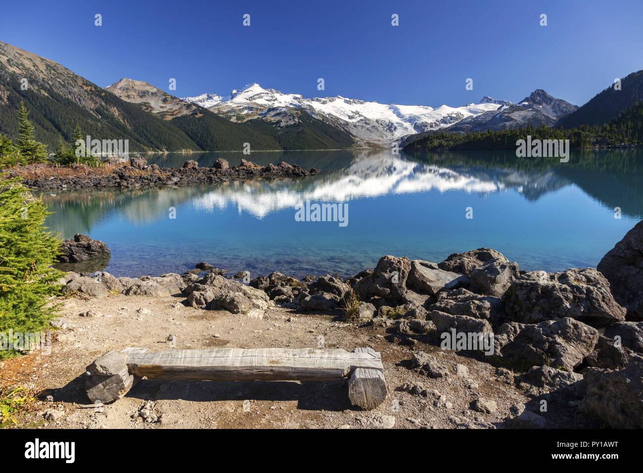 wooden-log-bench-and-distant-snowcapped-