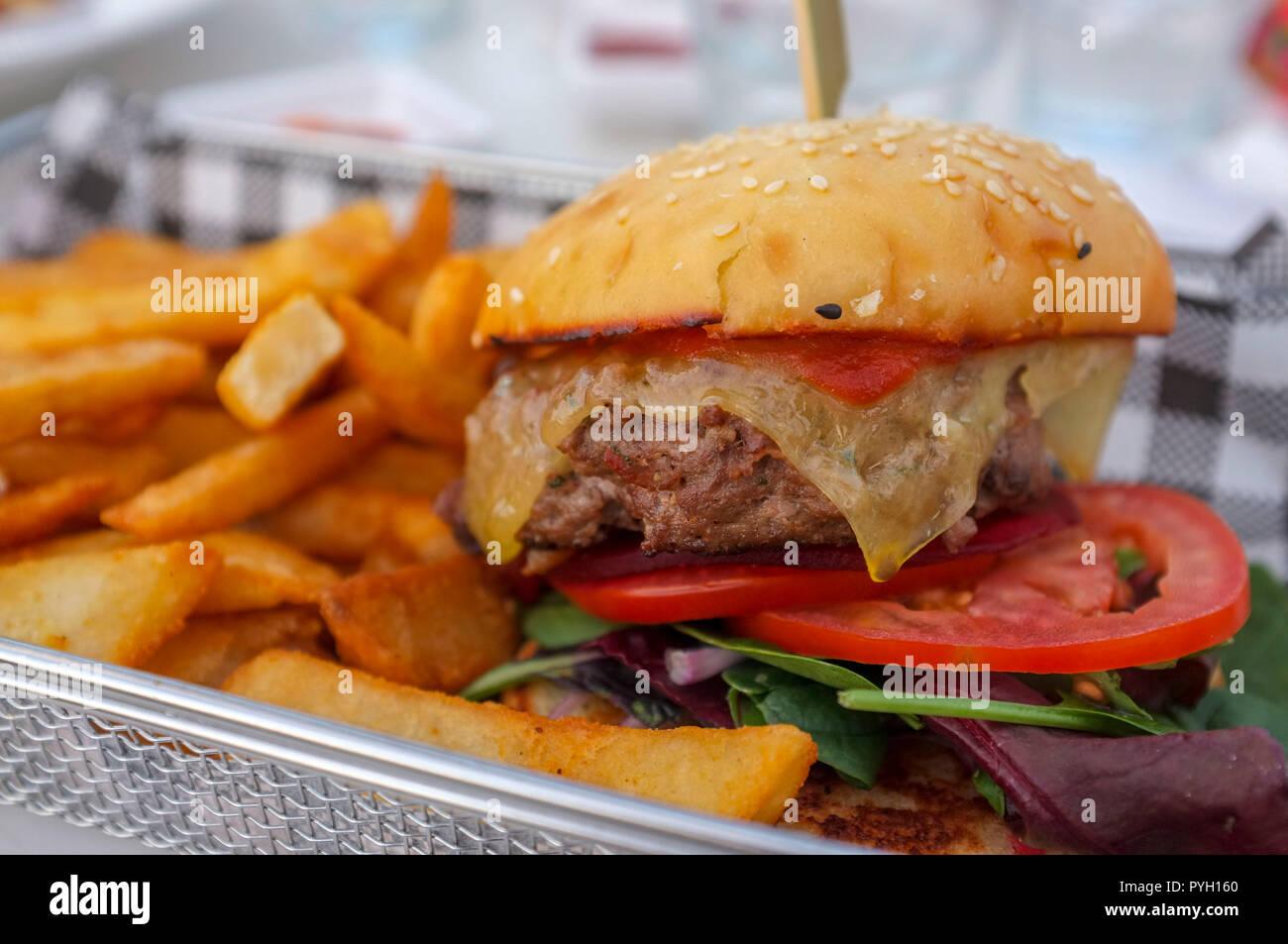 Hamburger with fries. Stock Photo