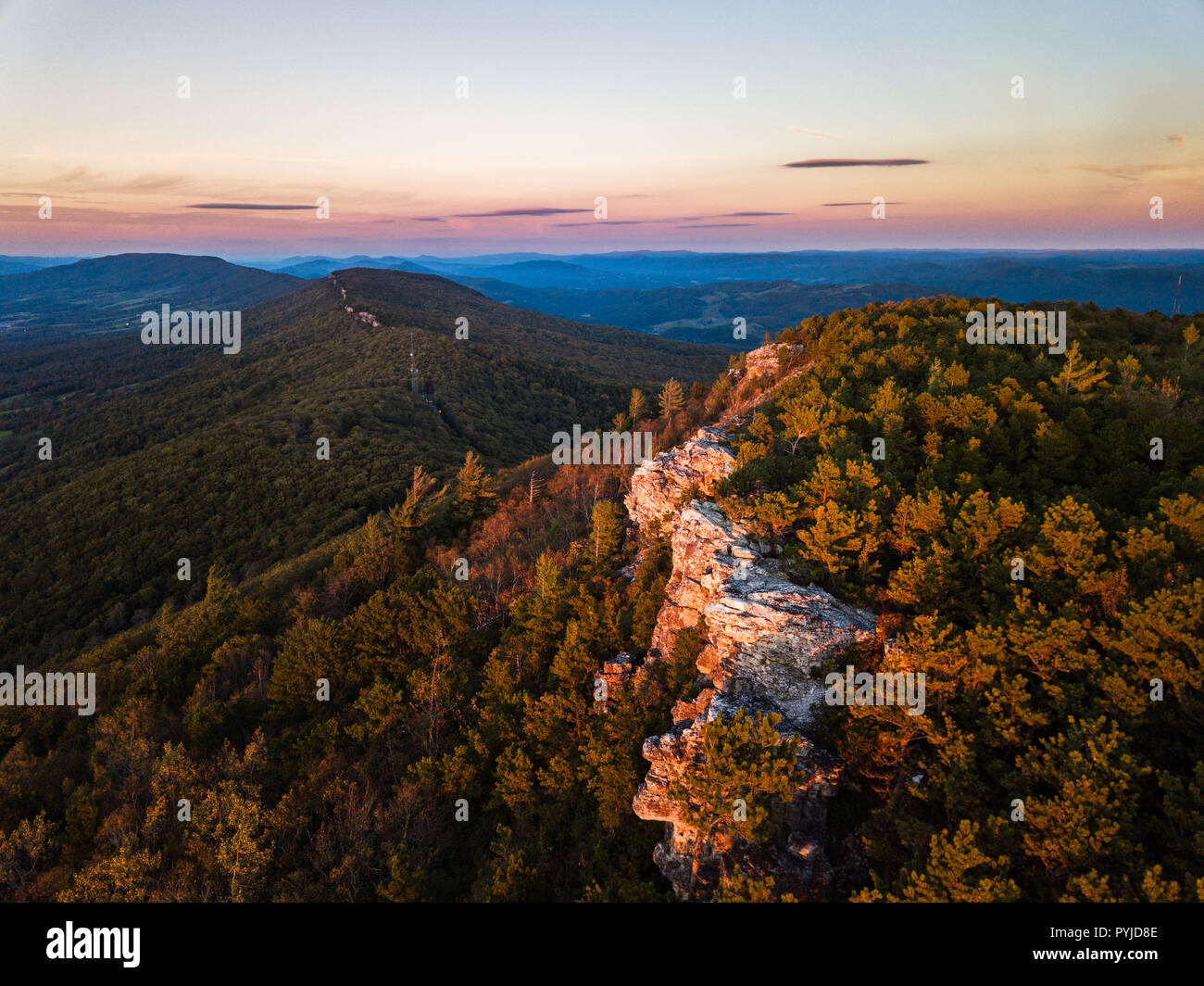 Aerial view of the southern ridge line quartzite rock of North Fork Mountain at sunset high above Germany Valley to the west and and the Shenandoah Va Stock Photo