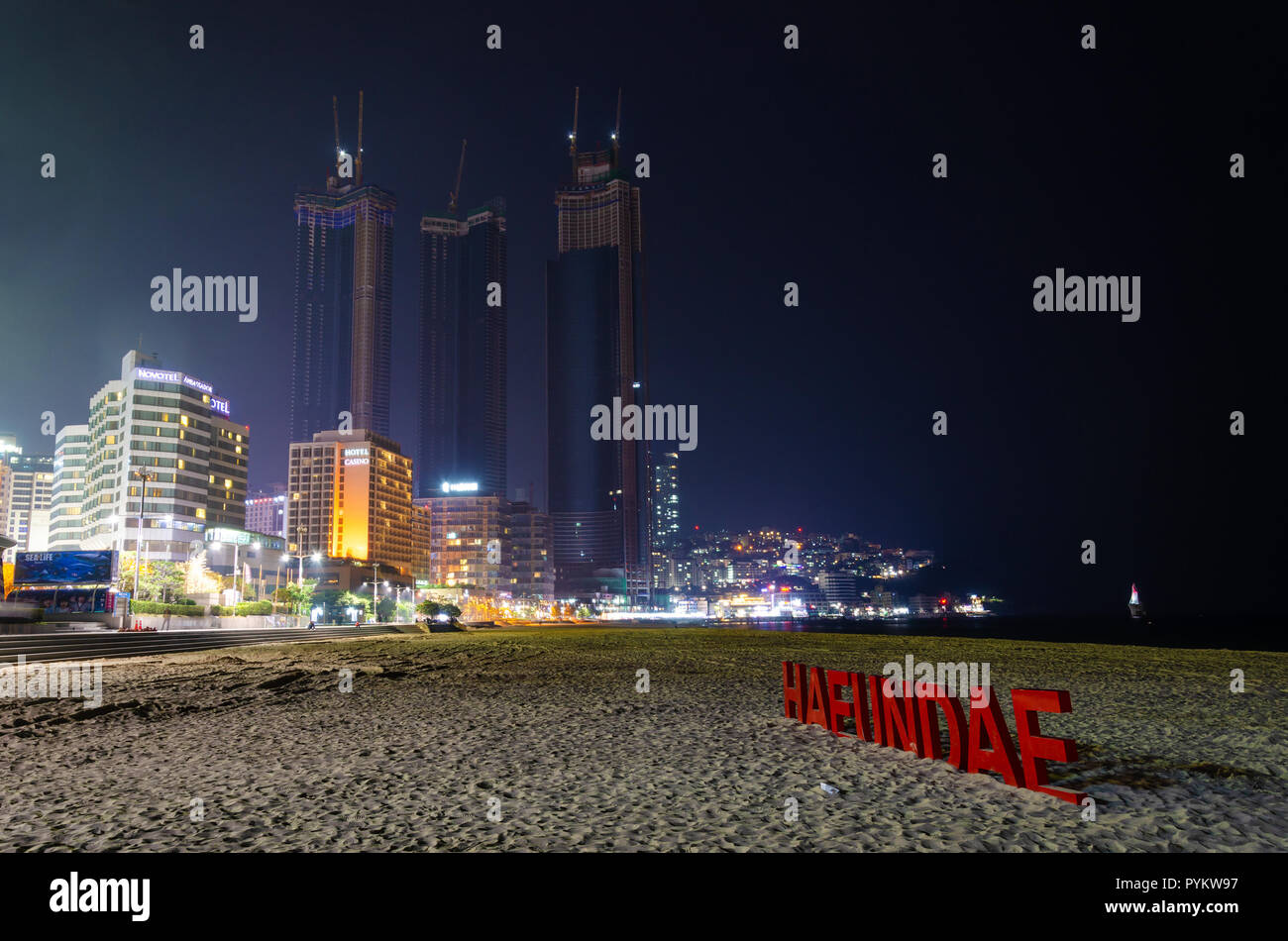 haeundai-beach-at-night-with-skyscrapers-of-the-city-lit-up-in-the-dark-haeundae-busan-south-korea-PYKW97.jpg