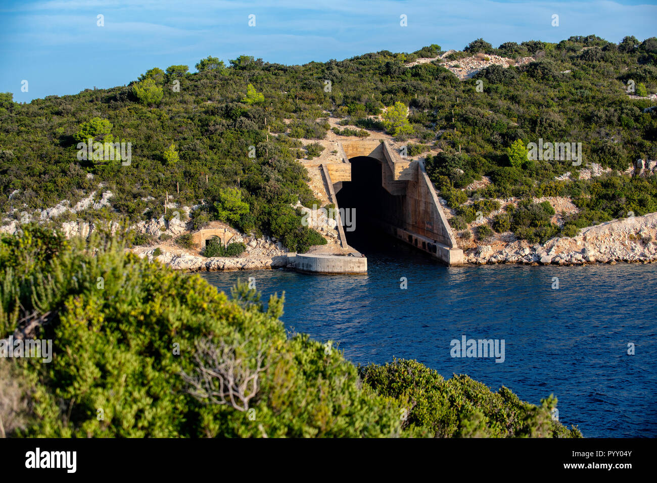 Abandoned submarine pen in Parja cove on the island of Vis, Croatia. Stock Photo