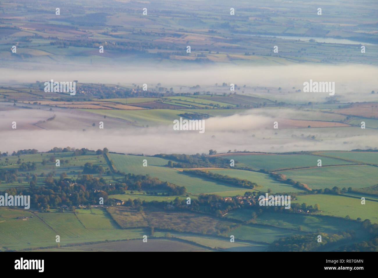 morning-mist-fog-ground-mist-ground-fog-low-on-cambridgeshire-countryside-viewed-from-a-plane-flying-overhead-aerial-view-space-for-copy-R07GMN.jpg