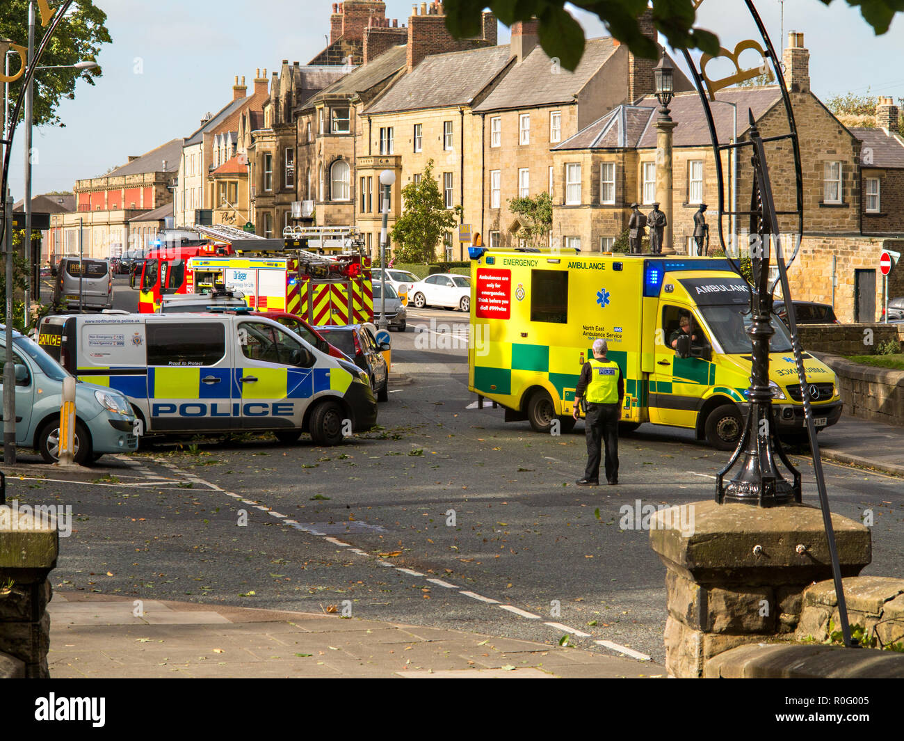 Emergency services fire police and ambulance paramedics attend a road traffic accident  at Alnwick Northumberland England UK - Stock Image