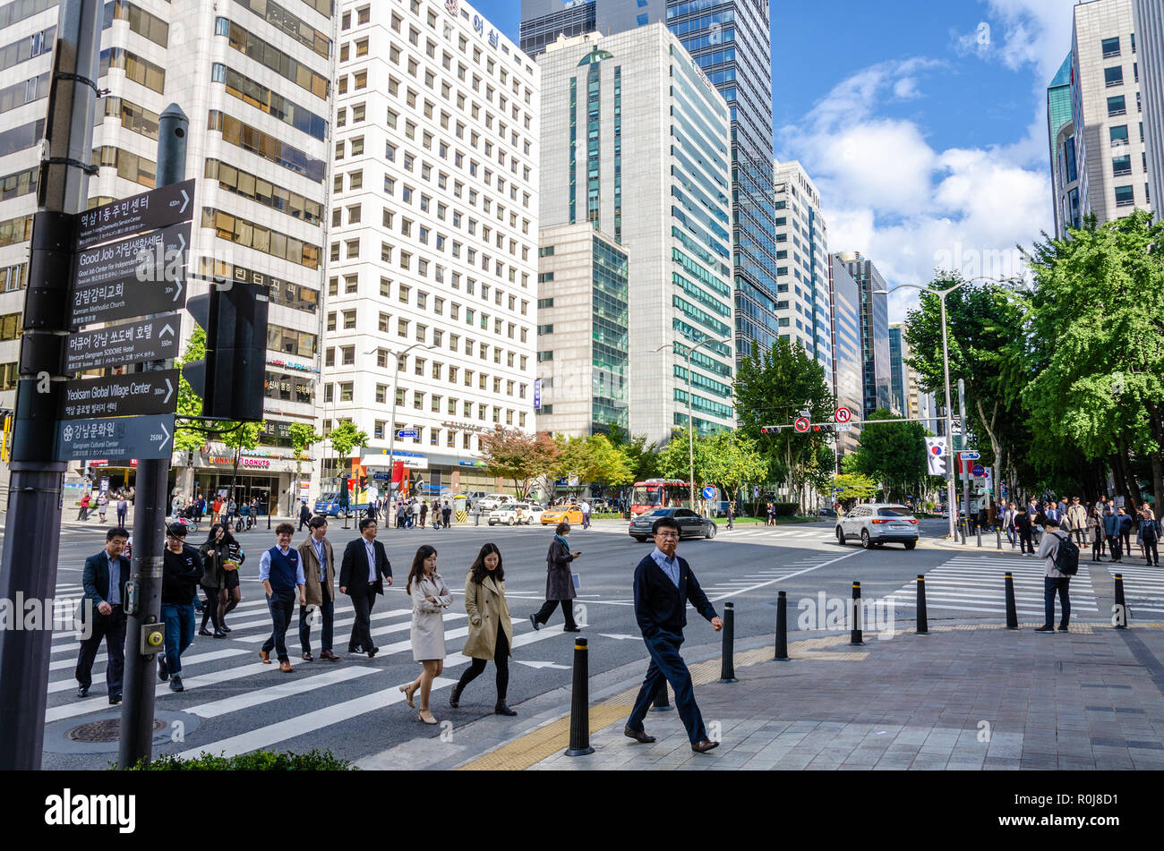 tall-buildings-against-a-blue-sky-with-clouds-in-this-cityscape-vew-of-the-gangnam-district-of-seoul-in-south-korea-R0J8D1.jpg