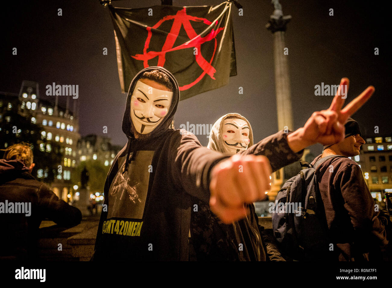 https://c7.alamy.com/comp/R0M7F1/hundreds-of-protesters-wearing-guy-fawkes-masks-gathered-in-london-for-their-annual-march-promoted-by-anonymous-an-international-group-of-hacking-activists-the-march-is-a-protest-against-corruption-in-power-it-coincides-with-bonfire-night-in-the-uk-which-commemorates-the-date-guy-fawkes-attempted-to-blow-up-the-houses-of-parliament-in-1605-5th-nov-2018-credit-velar-grantzuma-wirealamy-live-news-R0M7F1.jpg