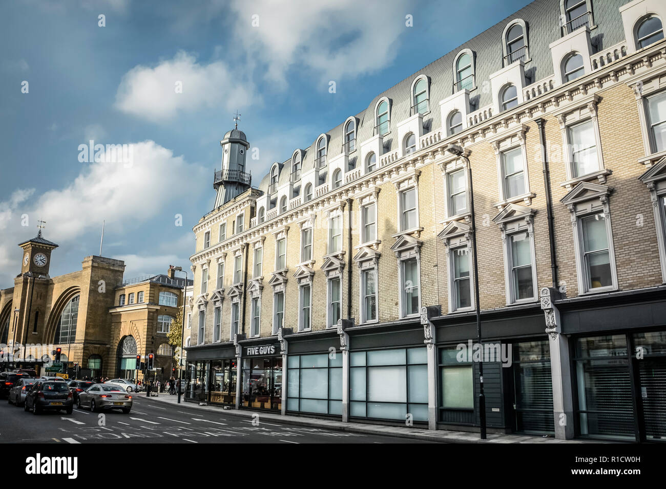 King's Cross station and the The Oysterhouse Lighthouse, Gray's Inn Road, Kings Cross, London, UK Stock Photo