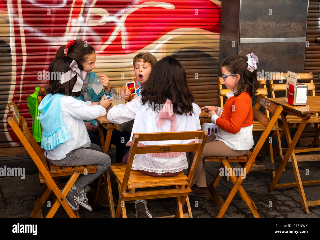 children-playing-cards-at-an-outdoor-tab